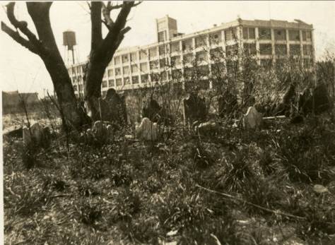 Another view of the Burroughs Cemetery, ca. 1922. The former Durkee factory (now Elmhurst Education Campus) is in the background (NYHS)